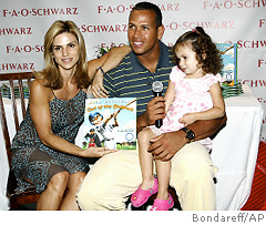 Make room for one more - Alex Rodriguez and his wife, Cynthia, smile with their daughter, Natasha, at a July signing of 'Out of the Ballpark,' the children's book A-Rod dedicated to his 2-year-old. Photo credit Bondareff/AP