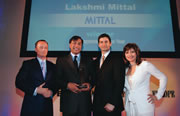 Lakshmi Mittal receives the 2005 award for entrepreneur of the year from Todd Thompson, flanked by CNBC presenters Simon Hobbs and Maria Bartiromo